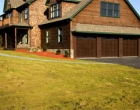 Raynor Showcase Stamped Carriage House Overhead Door Highland